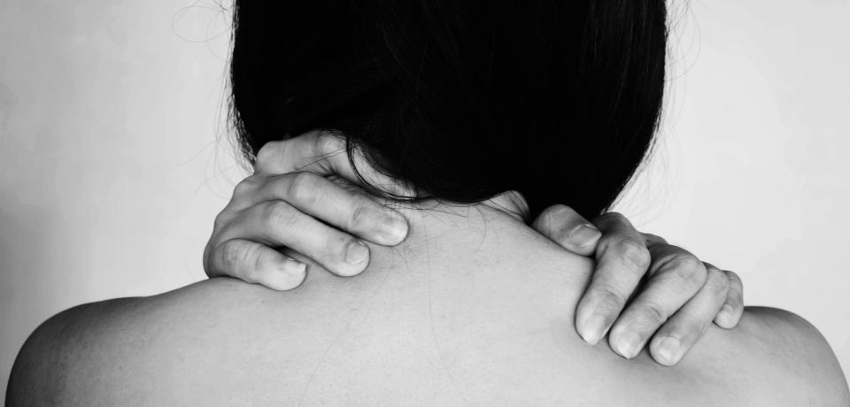 hands of woman around neck